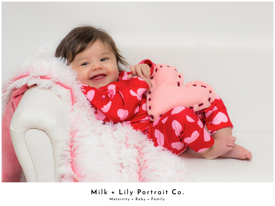 Kids in a photography studio for Valentine's Day Mini Sessions at Milk and Lily Portrait Co.