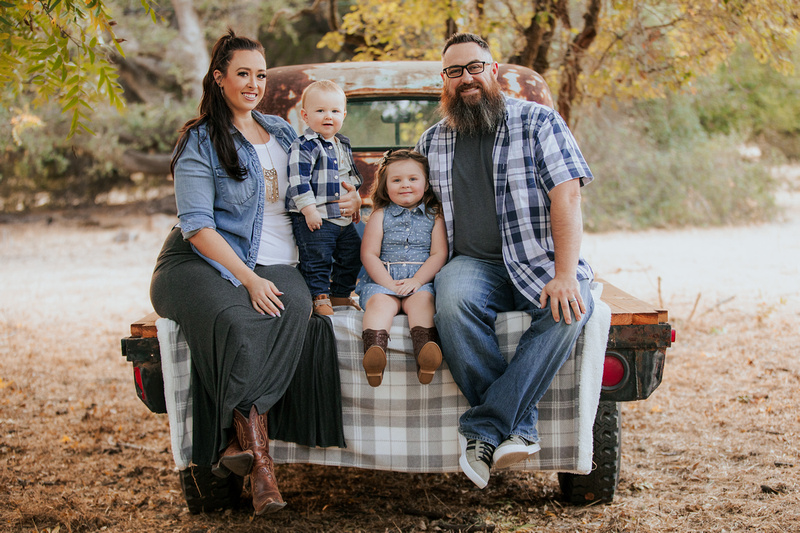 Fall photo session with picnic blanket in pick up truck